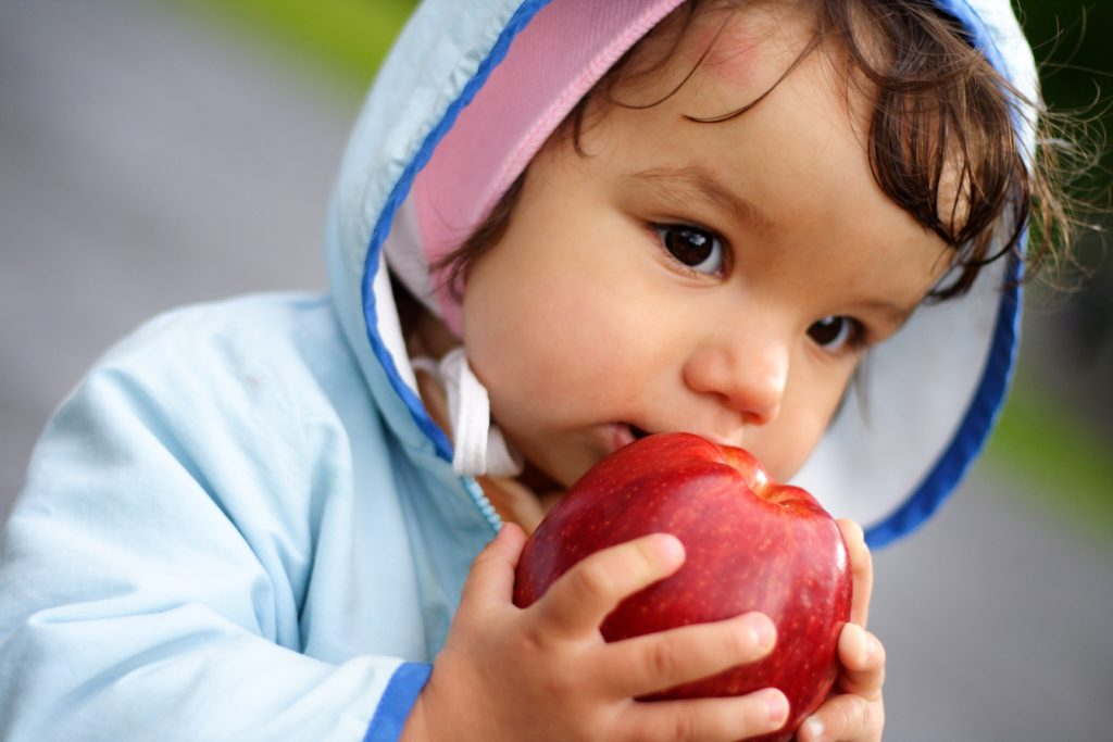 child-holding-an-apple