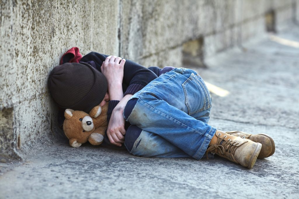 young-homeless-boy-sleeping-on-the-bridge-poverty-city-street-Image