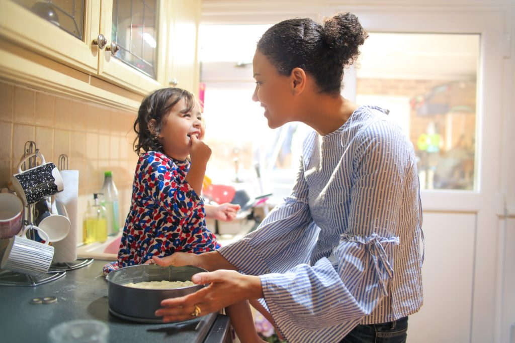 Sweet-mother-and-daughter-cooking-together-2-Image