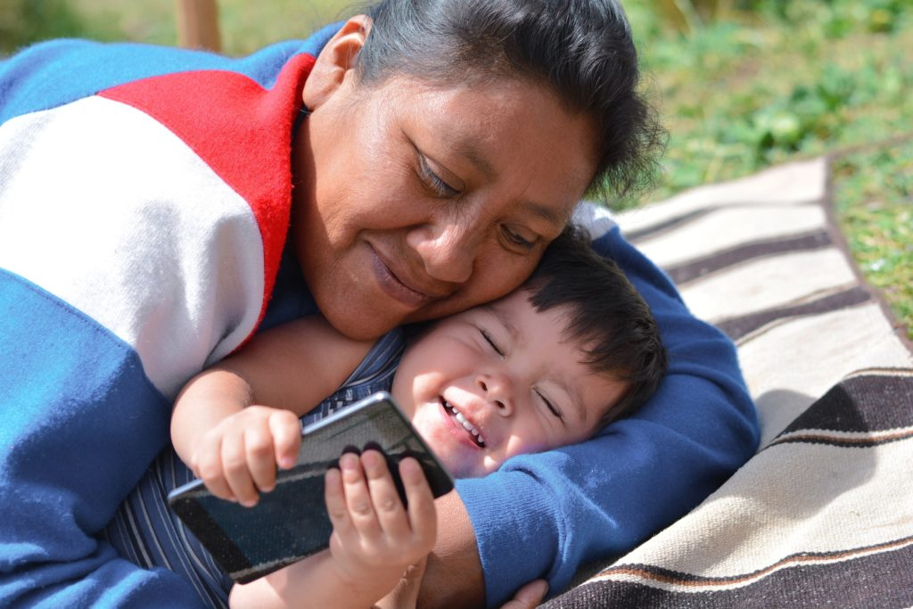 tender-portrait-of-native-american-woman-with-her-little-son-in-the-countryside