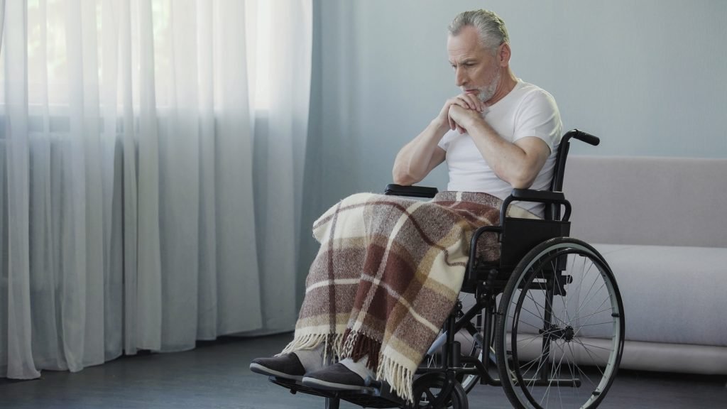 Handicapped-person-sitting-in-wheelchair-and-thinking-about-life-depression-Image